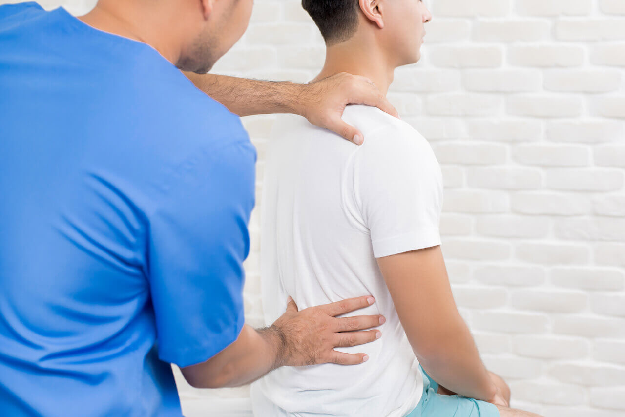 Ached by Lower Back Pain? Stand up Straighter with Physical Therapy